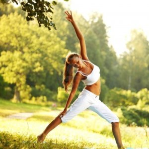 8586216-yoga-woman-on-green-park-background