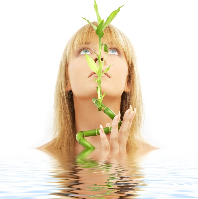 lovely blond with bamboo in water