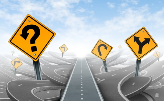 Questions and clear strategy and solutions for business leadership with a straight path to success choosing the right strategic path with yellow traffic signs cutting through a maze of tangled roads and highways.
