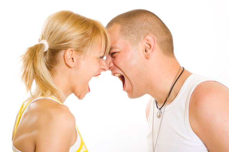 Angry twenty something couple yelling at each other